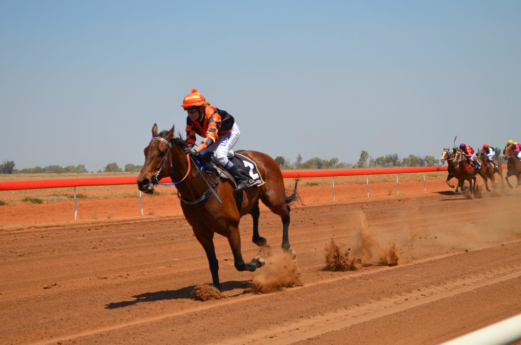Lone Assassin, ridden by Gemma Steele races to the finish line in race one in Charleville. Photo Ali Kuchel / Western Times