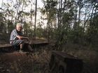 Alex Tkaczynski sits among the remnants of a planned American army base in Tinana.