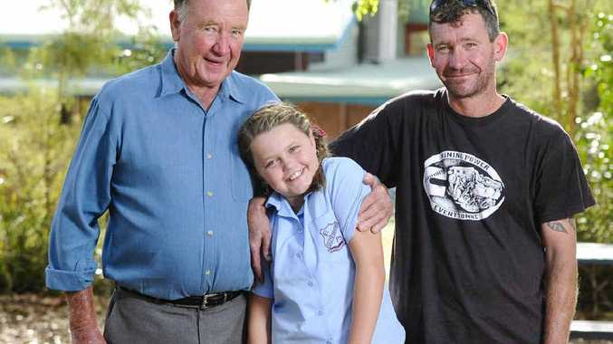CONNECTION: Greg Ellis with his granddaughter Breanna, 11, and his son Anthony at Coutts Crossing Public School. Four generations of the Ellis family, including Greg's parents, have attended the school. PHOTO: JOJO NEWBY