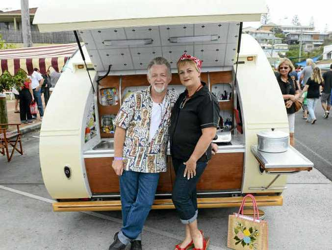 ON THE ROAD: Mark and Glenda Hoskins of Brisbane with their replica 1964 cabin car which Mark built. Mark and Glenda have attended three previous Yamba Rod Runs and their cabin car is towed by a 1963 Humber Super Snipe. Mark says he is not a tradesman but rather a timber lover. PHOTO: TERRY DEEFHOLTS