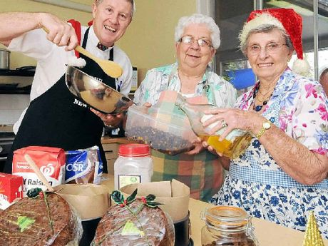 POP-UP SHOP: Rev Alan Shaw with Bev Carroll and Nan Crozier from St Andrew's Anglican Church in Lismore baking Christmas cakes for the annual pop-up Christmas shop in Magellan St, Lismore.