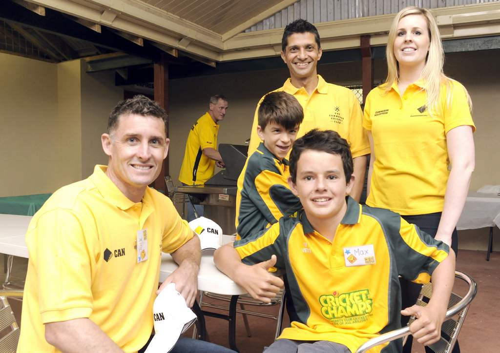 Michael Hussey with some of the kids in the cricket club.