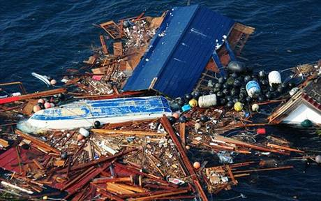 An enormous floating island of debris from Japan's 2011 tsunami is drifting towards the coast of America US Navy handout