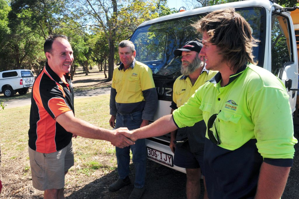 LUCKY RESCUE: Rob Modrow thanks Bundaberg Regional Council Parks and Gardens staff Neil Thomson, Paul Fruscalzo and Dylan Rogers for rescuing his dad from drowning in the Burnett River after his boat capsized. Photo: Max Fleet / NewsMail