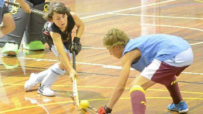 STICKING TO IT: Grafton indoor hockey representatives train for the state championships. PHOTO: ADAM HOURIGAN