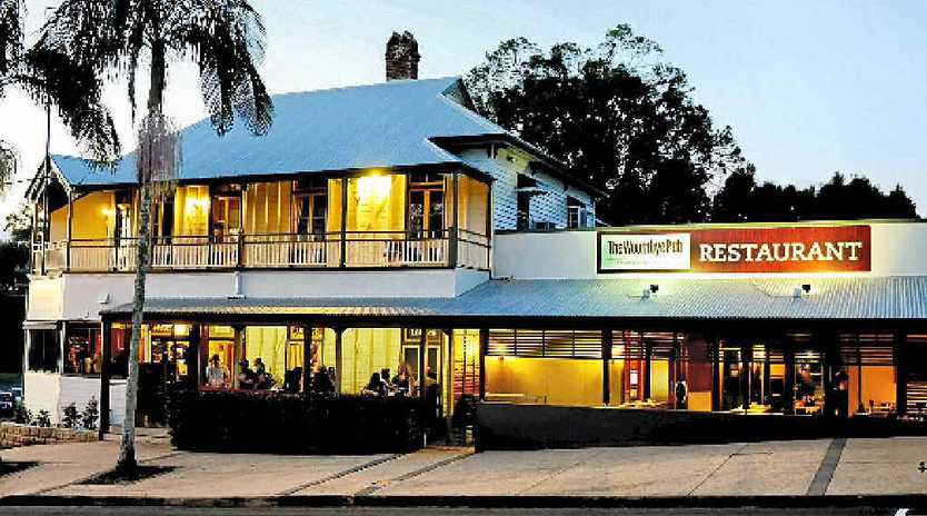 LEFT: The Woombye Pub in the 1880s. RIGHT: The Woombye Pub has become the cornerstone of the Woombye township.