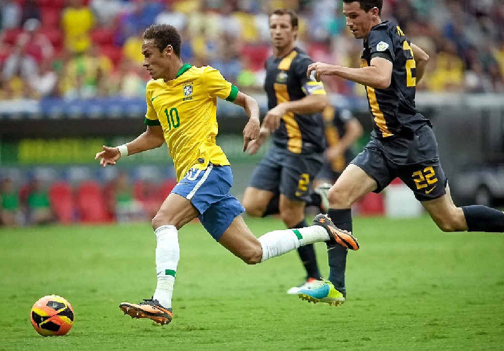 Ryan McGowan chases Neymar during the international friendly between Brazil and Australia at the Mane Garrincha national stadium last month.