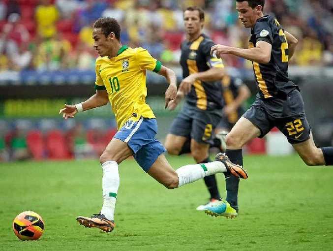 Ryan McGowan chases Neymar during the international friendly between Brazil and Australia at the Mane Garrincha national stadium last month.