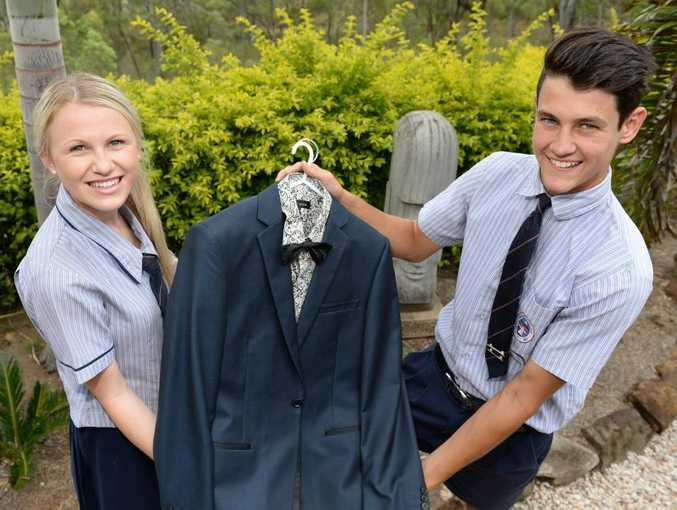 Riley Neaton (right) shows Tamika Langdon the suit he will be wearing to the Emmaus College formal. Photo: Chris Ison / The Morning Bulletin
