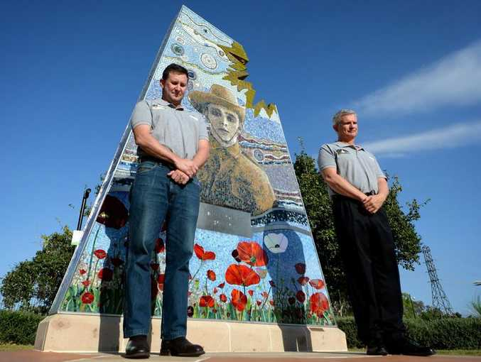 Members of the 9th Battalion Living History Unit David Bell and Brian Phelan at the Jack Leak Memorial. Photo Allan Reinikka / The Morning Bulletin