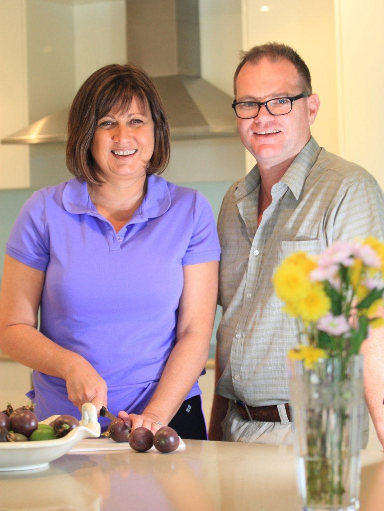 Justine and Craig Elliot in their kitchen.