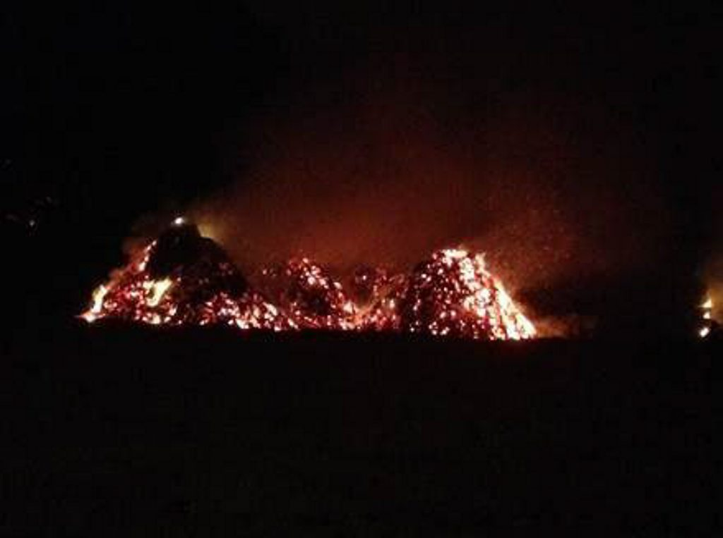 Brookwater Arsonist struck again on 6 August 2013 - Multiple woodchip piles burned for days. A pall of smoke over Bellbird Park and Brookwater after a fire lit by a suspected arsonist. Photo: Contributed