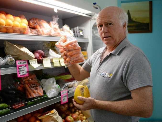 Peter Lewis with some organic produce. Photo Allan Reinikka / The Morning Bulletin