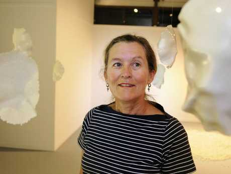 Senior lecturer in Visual Arts at the University of Southern Queensland, Alexis Tacey with work by Lynette Larson,