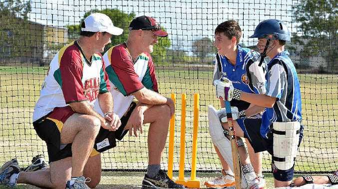 Bulls Masters players Jimmy Maher and Geoff Foley with Mackay juniors Blair Holden and Adam Zurvas at a cricket clinic at Harrup Park.