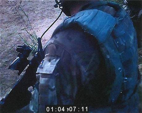A still from a video showing the shooting of an injured Afghan insurgent in Helmand province.