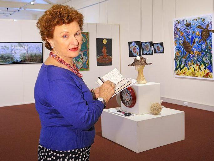 Julie Ewington inspects the entries of the 2013 Rio Tinto Alcan Martin Hanson Memorial Art Awards Photo Mike Richards / The Observer
