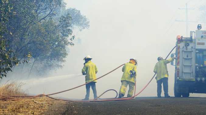 Crews monitor bushfire as smoke blankets surrounding areas