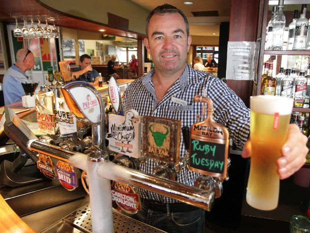 SOMETHING BREWING: Duporth Tavern manager Clayton Williams serves up a schooner of Peroni, an Italian beer. Australians are drinking less beer than they were five years ago, but we are drinking more imported beer.
