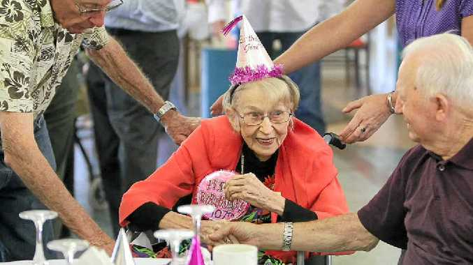 PARTY GIRL: Monica Guy celebrates her 107th birthday at Claremont Nursing Home at Nambour, where staff say the vibrant woman is a pleasure to look after.
