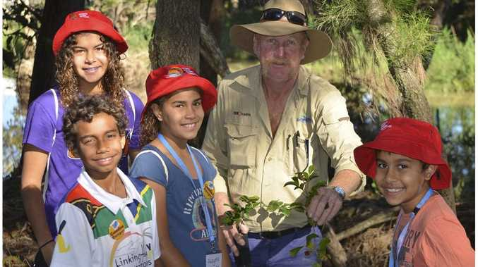 Paddy Delalande with the young Gundoo Junior rangers doing a clean up at the Capricorn Coast Photo Contributed