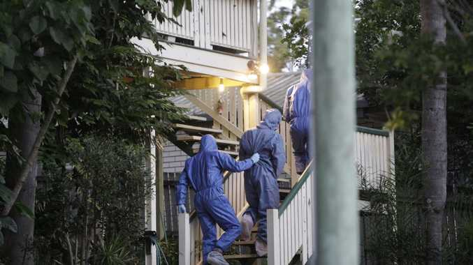 A man is led around by police at a house on Horseshoe Bend at Buderim after a lady was found in a burnt out car off Sippy Creek Road.