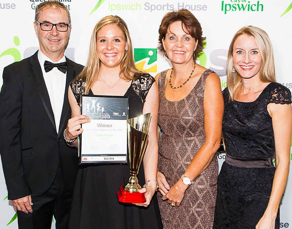 CELBRATING EXCELLENCE: Robert (left) and Josie (second from right) Barty accepted their daughter Ashleigh's Sports Excellence award, alongside Junior Sportsperson of the Year winner Leah Neale (second from left) with QT general manager Carly Gregory at the QT-City of Ipswich Sports Awards on Friday night.