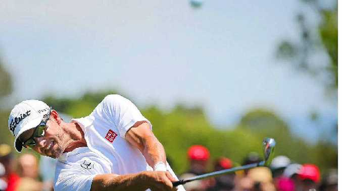 GRIP AND RIP: Adam Scott drills an iron shot during the final round of the Australian PGA Championship at Royal Pines.