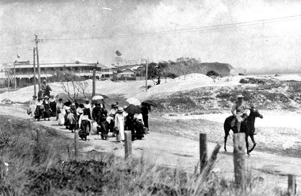 The first batch of young women is escorted to a quarantine camp at Shark Bay.