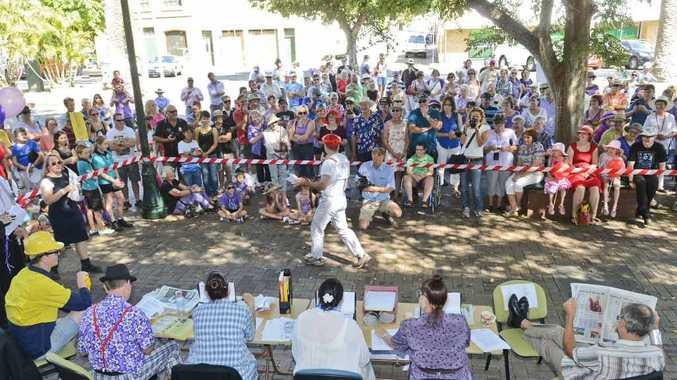 HOLIDAY OR EVENT: A large crowd watches one of Clarence Valley Council's public holiday-inspired performance on Jacaranda Thursday. PHOTO: ADAM HOURIGAN