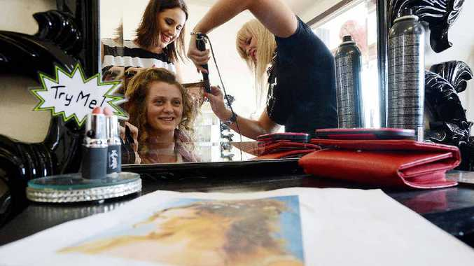 A CUT ABOVE THE REST: Chloe Felton from Ballina High School pictured getting her make up and hair done for her year 12 formal by Ange Mullinuex (black and white top) and The owner of E-Clips Hair By Emily, Emily McKinnon, at E-Clips Hair, River Street, Ballina. Photo Patrick Gorbunovs