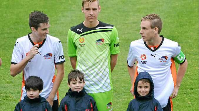 ON TRACK: Denver Crickmore (centre) on debut for the Brisbane Roar youth side against the Wanderers in Sydney.