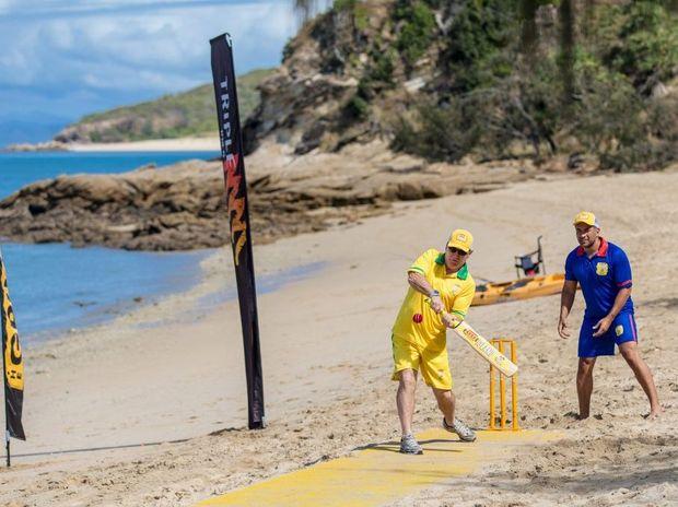 Australian cricket legend Allan Border plays a shot as England captain Adam Hollioake looks on during the XXXX GOLD five-a-side Ashes beach cricket match on XXXX Island.