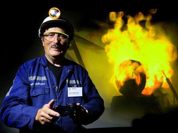 LAUNCH DAY: Simtars executive mining engineer Martin Watkinson demonstrates the virtual reality training simulator.