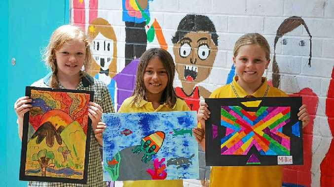 SHOW STOPPERS: Bangalow Primary School Year 4 students (from left) Summer Bannerman, Delilah Hatch and Millie Crabtree with their art entries for this year's Bangalow Show.
