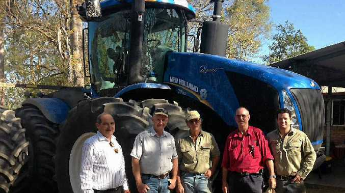 ON THE LEVEL: Carlisle Motors managing director Richard Deguara and sales manager Nobby Byrne congratulate Craig Hutley, Tony Crowley and Lee Hutley on their purchase of a New Holland T9 tractor.