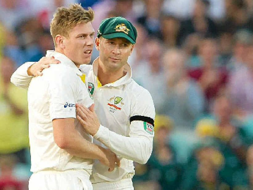 Michael Clarke, right, congratulates James Faulkner for taking the wicket of England's Jonathan Trott at the Oval on August 25.