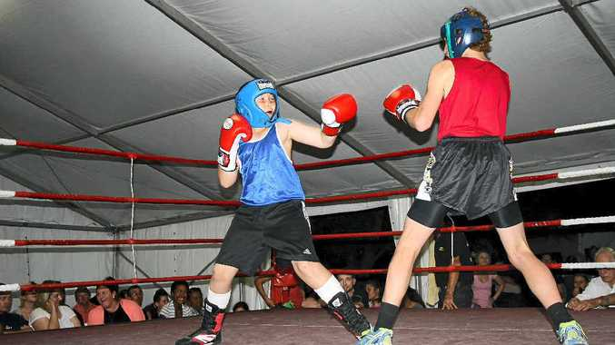 TOE TO TOE: Laidley fighter Jackson 'Dingo' Kwast fights well against Gympie's John Morris in the 49kg exhibition match during the Laidley Boxing Club's fight night.