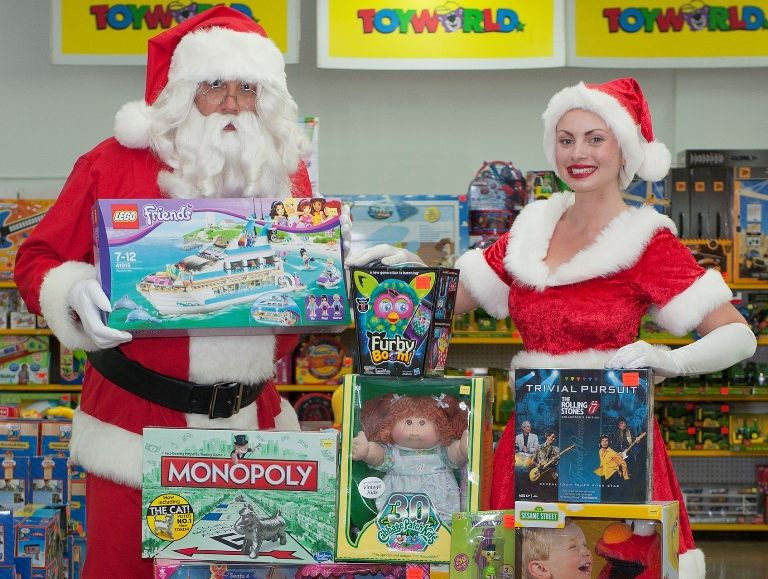 Santa and helper with the top 10 toys of all time, according to a Toyworld survey