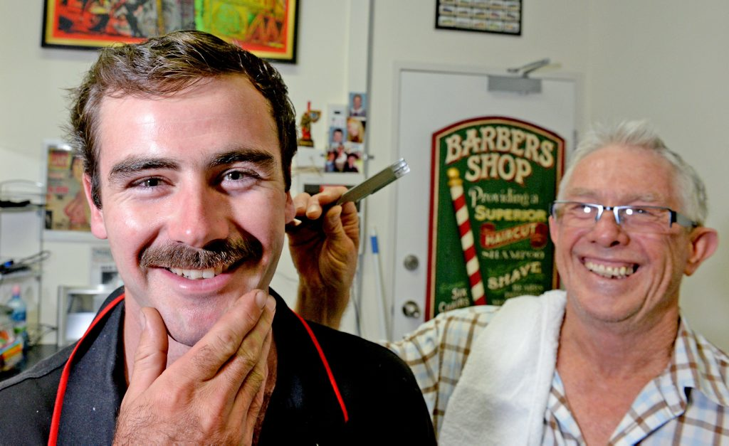 Cabarita Movember participant Mitch Beggs gets a close shave from Tony West at The Barber Shop in Kingscliff.
