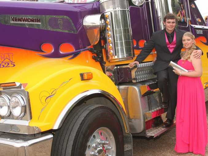 READY TO RIDE: Glenmore High School leaver Louise Kummerfeld (right), 17, and boyfriend James Read, 18, get ready to head to their formal in their ride. Photo: Austin King / The Morning Bulletin