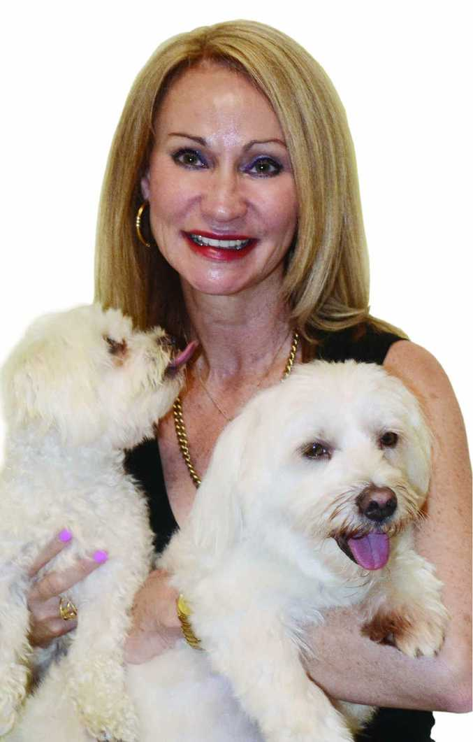 TOP 90: Rockhampton's Cooke Property agent Annette Waddell and her dogs.