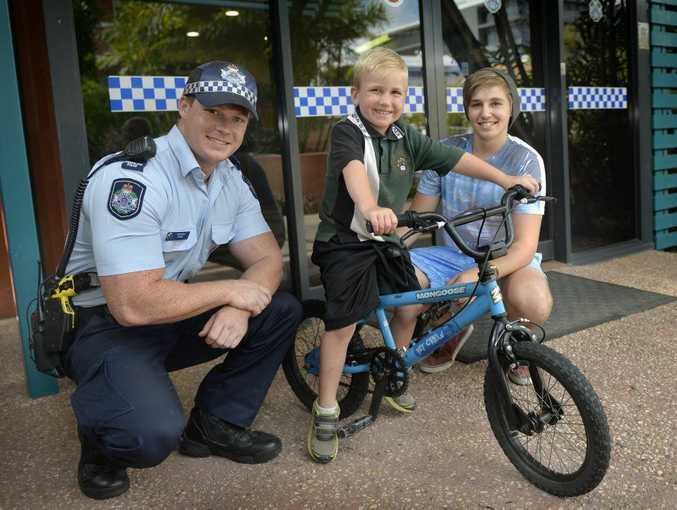 Kaden Lowe shows off his new bike with Constable Mitch Nelis and neighbour Ashley Johnson.