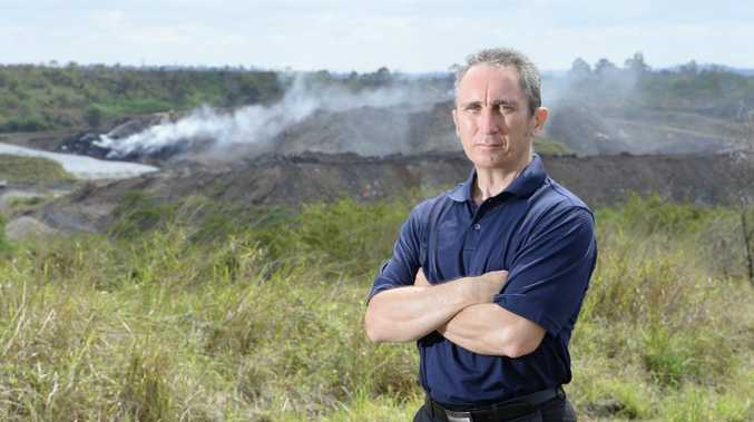 Jim Dodrill talks about the fire in the dump behind him and his concerns for local residents. Photo: Rob Williams / The Queensland Times
