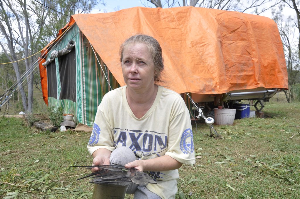Helidon resident Lee Williams inspects damage to her caravan after a hail storm swept through the Lockyer Valley.