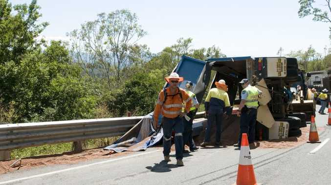 A runaway trailer rolled on the Toowoomba Range, blocking both eastbound lanes for hours.