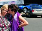 DOUBLE DECKER: Maureen Gerrard and her niece Jane Gerrard try to see the funny side of things after a car lost control outside the Bundaberg RSL and launched off the curb on top of Maureen's car.
