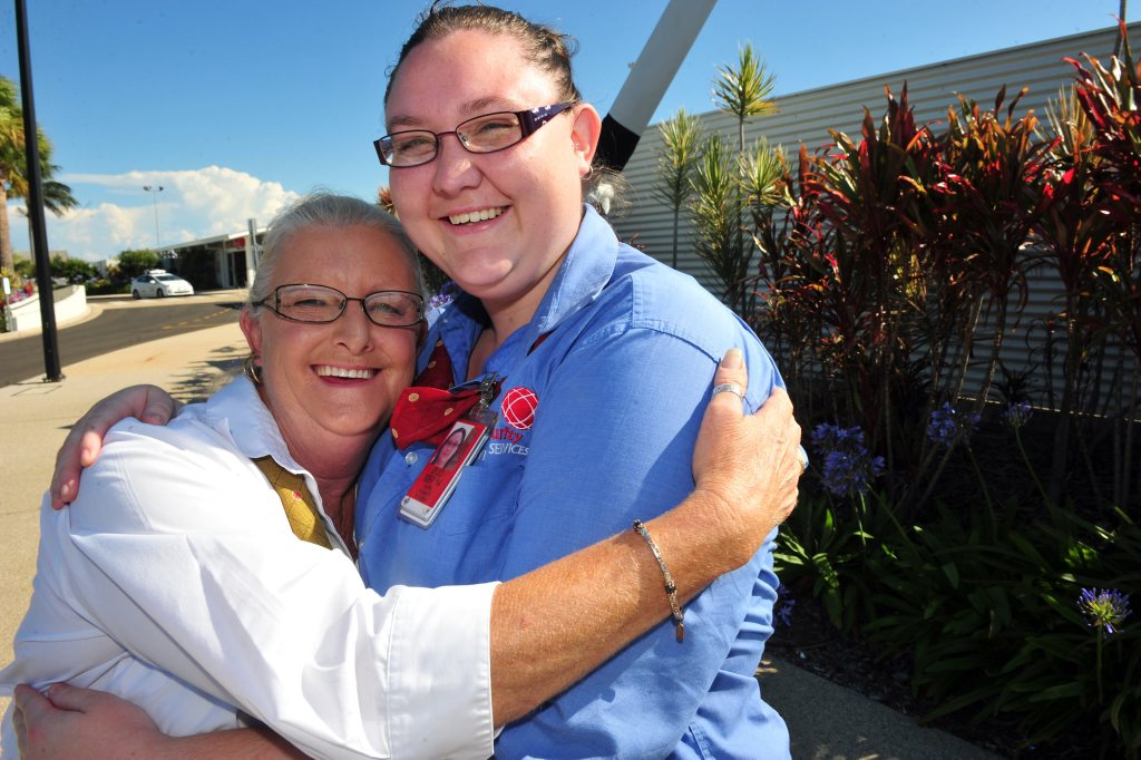 YOUR BACK: When Caitlin Fogarty (right), MSS aviation protection officer hurt her back she thought her working days at Bundaberg Airport were over but Bundaberg Airport MSS Security site supervisor Jan Slade (left) kept her job open awaiting her return, now she's back. Photo: Max Fleet / NewsMail
