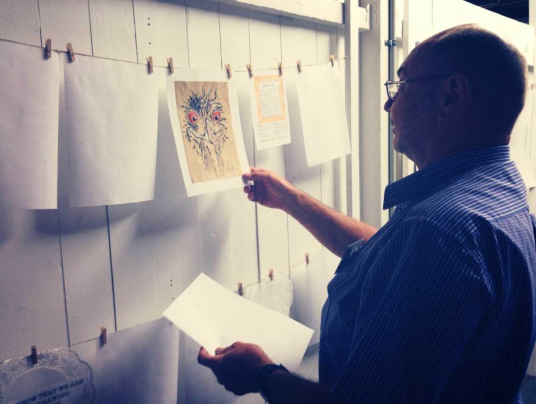 Volunteer Bob Watson participating in the 'Swap it!' exhibition.
