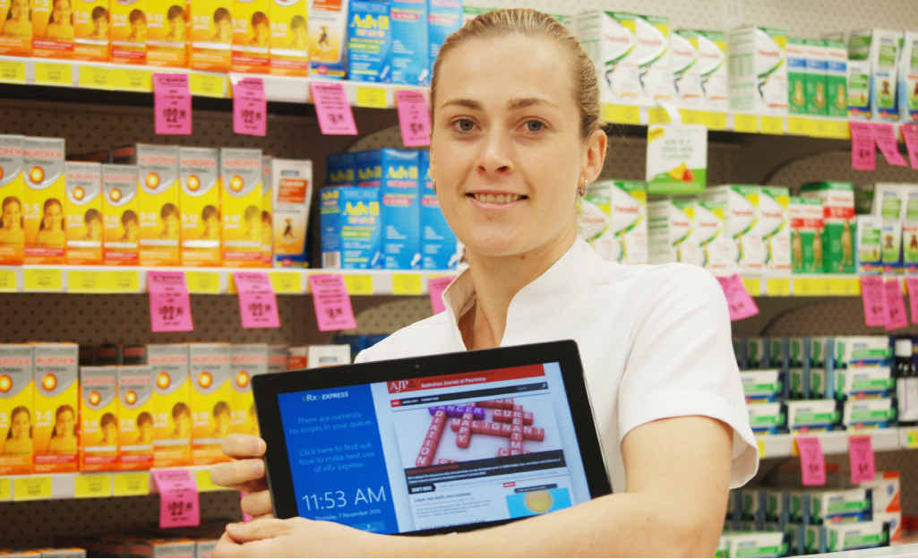 TECHNOLOGY: Direct Chemist Outlet Emerald's pharmacist Jess Burrey with the eRx Express app.